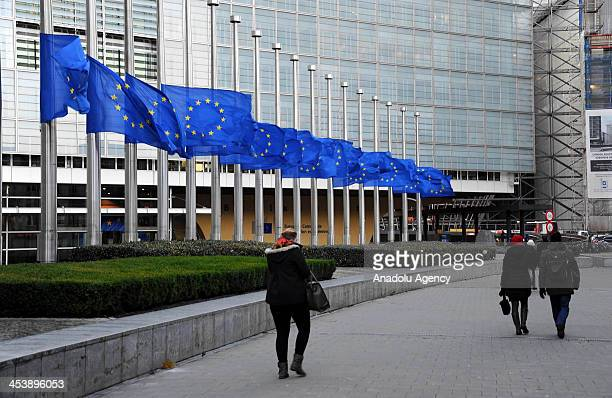 European Union flags fly at half mast to honour South African leader Nelson Mandela in Brussels Belgium on December 6 2013 Former South African...