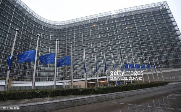 European Union flags fly halfmast at the European Parliament in Brussels on January 8 following an attack on January 7 against French satirical...