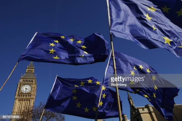 European Union flags fly in front of Elizabeth Tower commonly referred to as Big Ben during a Unite for Europe march to protest Brexit in central...