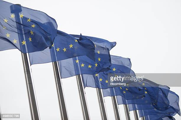 European Union flags fly outside the European Council building in Brussels Belgium on Tuesday Nov 24 2015 Authorities in Brussels extended the city's...