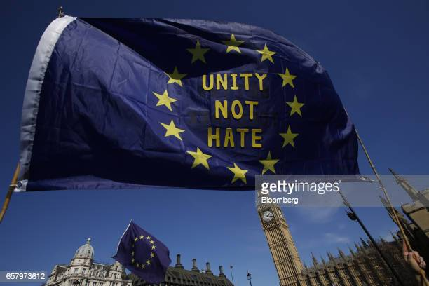 European Union flags wave as demonstrators march during a Unite for Europe march to protest Brexit outside the Houses of Parliament in London UK on...