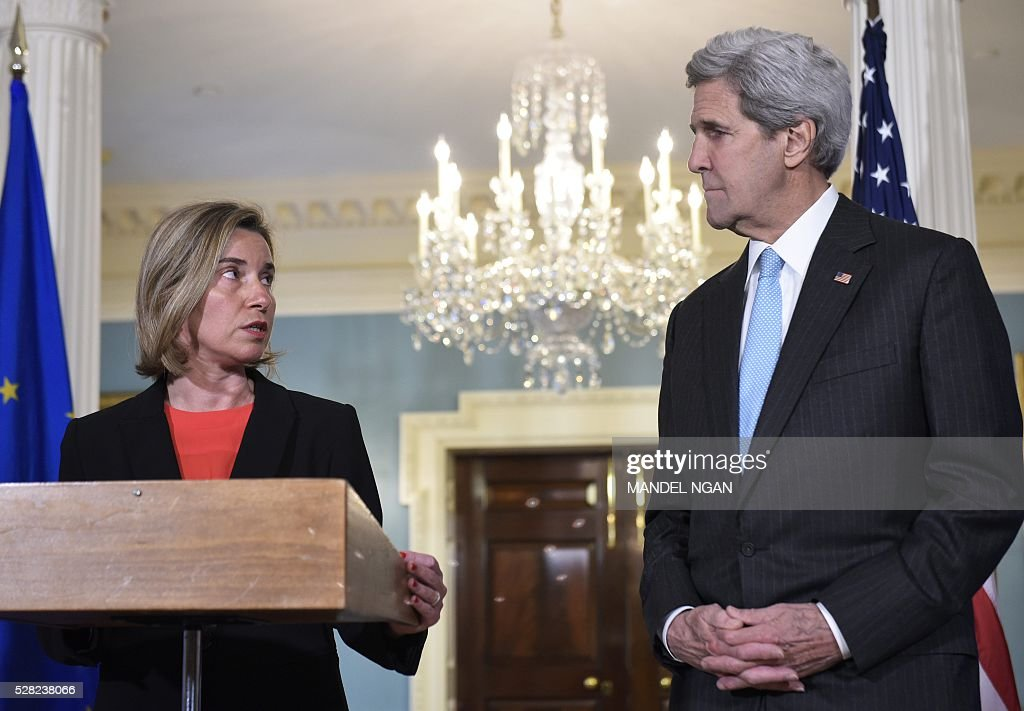 European Union Foreign Affairs and Security Policy High Representative Federica Mogherini (L) speaks during a meeting with US Secretary of State John Kerry at the State Department on May 4, 2016. / AFP / MANDEL