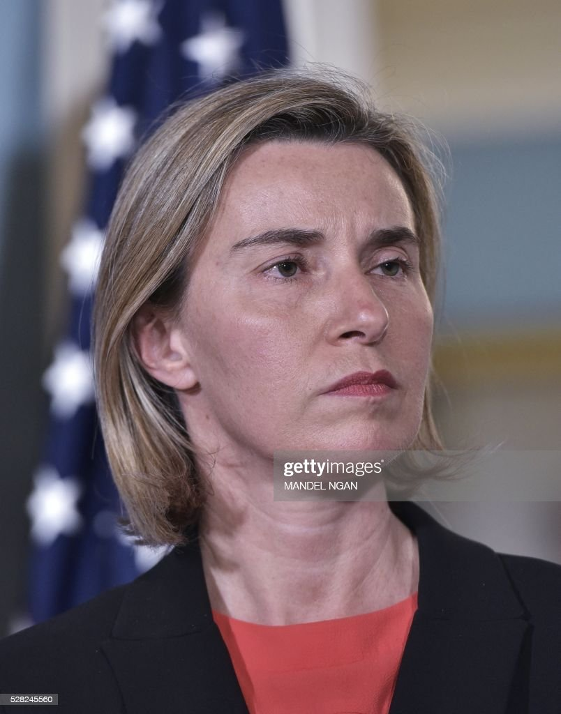European Union Foreign Affairs and Security Policy High Representative Federica Mogherini looks on as US Secretary of State John Kerry speaks to the press at the State Department on May 4, 2016. / AFP / MANDEL