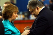 European Union foreign policy chief Catherine Ashton talks with Greek Foreign Minister Evangelos Venizelos before the Foreign Ministers Meeting at...
