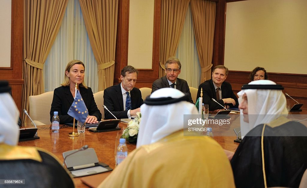 European Union High Representative for Foreign Affairs, Federica Mogherini (back-L), looks towards Saudi Foreign Minister Adel Al-Jubair (front-R) during a meeting in Jeddah on May 30, 2016. / AFP / STRINGER