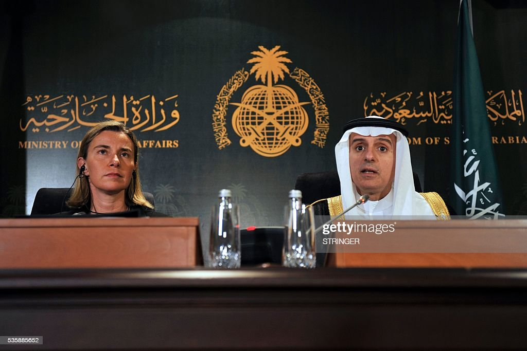European Union High Representative for Foreign Affairs, Federica Mogherini (L), listens to Saudi Foreign Minister Adel al-Jubeir during a press conference in Jeddah on May 30, 2016. / AFP / STRINGER