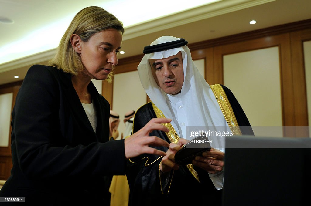 European Union High Representative for Foreign Affairs, Federica Mogherini (L), speaks to Saudi Foreign Minister Adel al-Jubeir ahead of a meeting in Jeddah on May 30, 2016. / AFP / STRINGER