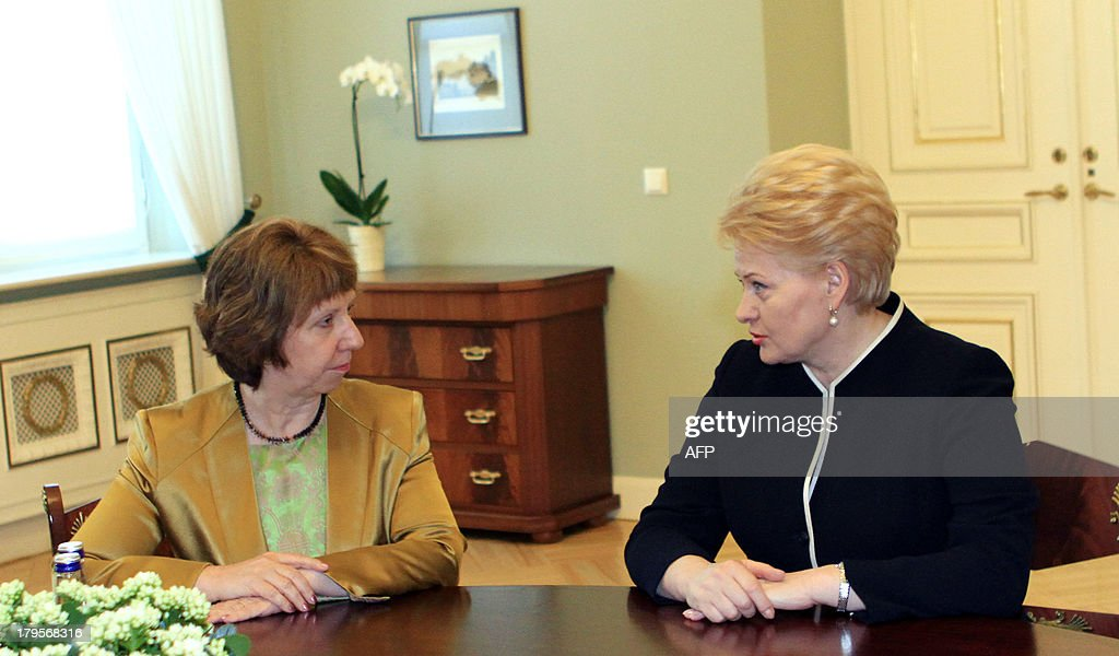 European Union High Representative for Foreign and Security Policy Catherine Ashton (L) is welcomed by Lithuania's President Dalia Grybauskaite before their meeting in Vilnius on September 5, 2013.