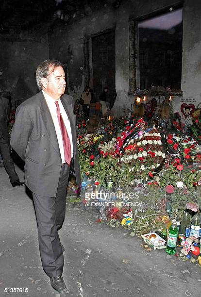 European Union Human Rights Comissioner Alvaro GilRobles stands in the ruined building of the school in Beslan paying his last respects to the...