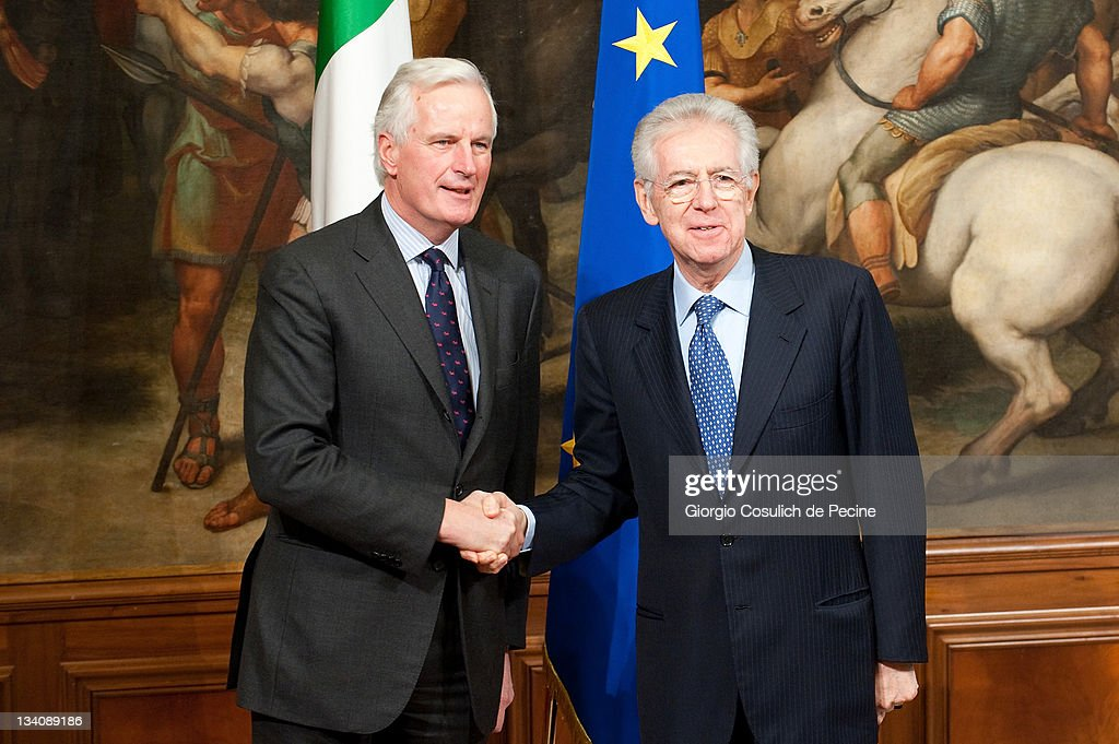 European Union Internal Market Commissioner <a gi-track='captionPersonalityLinkClicked' href=/galleries/search?phrase=Michel+Barnier&family=editorial&specificpeople=220639 ng-click='$event.stopPropagation()'>Michel Barnier</a> meets Italian Prime Minister <a gi-track='captionPersonalityLinkClicked' href=/galleries/search?phrase=Mario+Monti&family=editorial&specificpeople=632091 ng-click='$event.stopPropagation()'>Mario Monti</a> at Palazzo Chigi on November 25, 2011 in Rome, Italy. The Italian Prime Minister <a gi-track='captionPersonalityLinkClicked' href=/galleries/search?phrase=Mario+Monti&family=editorial&specificpeople=632091 ng-click='$event.stopPropagation()'>Mario Monti</a> reiterated the commitment to achieve the objectives set, especially reaching a balanced budget by 2013. Rehn also mentioned in his address that on November 29 the first assessment by EU experts on Italy's performance since the implementation of their austerity measures would be due.