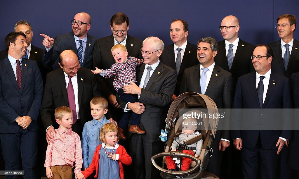 European Union leaders including the President of the European Council, Herman Van Rompuy (C) with his grandchildren, pose for a family photograph at the headquarters of the Council of the European Union on day one of a two-day European Council meeting on October 23, 2014 in Brussels, Belgium. David Cameron has come in for criticism from outgoing European Commission president Jose Manuel Barroso after Downing Street said the Prime Minister will lay out plans to limit the rights of EU migrants to work in Britain as well as announcing a plan to quit the European Court of Human Rights and replace it with a UK Bill of Rights.