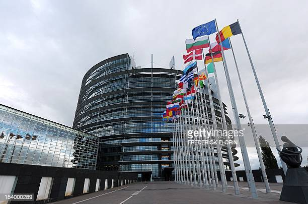 European Union member countries' national flags wave in front of the European Parliament on October 12 2012 in Strasbourg eastern France The Nobel...