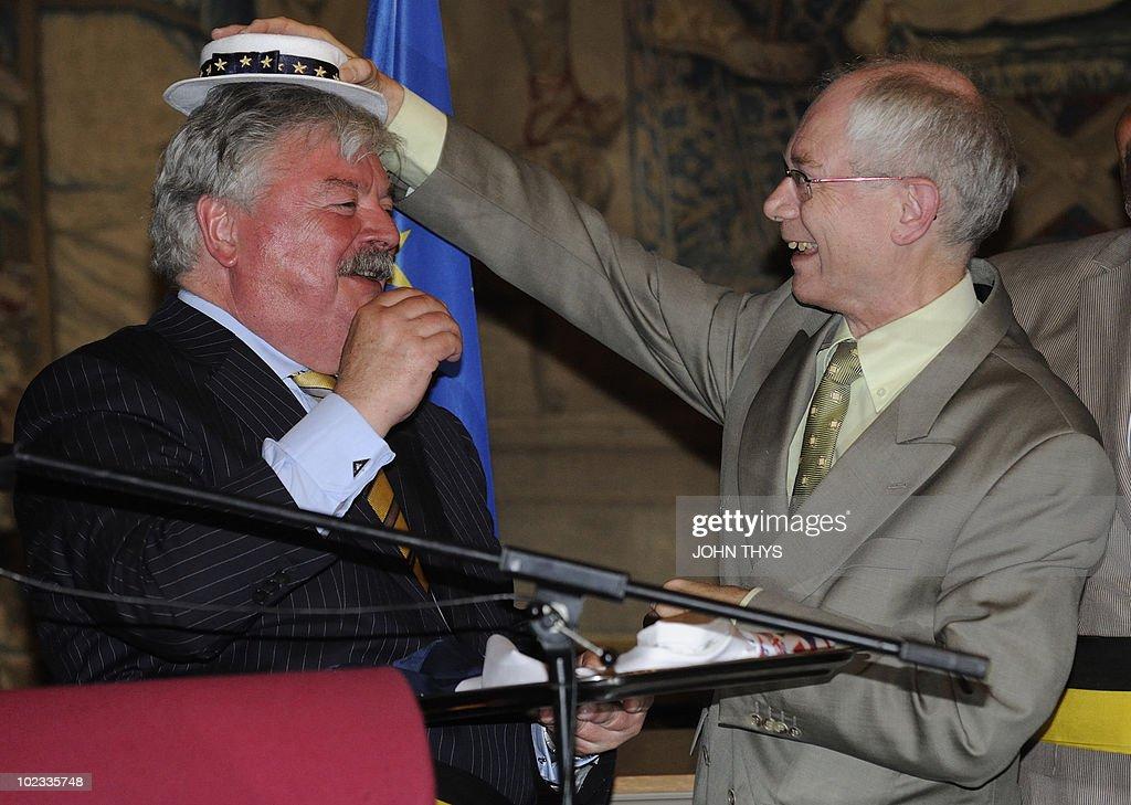 European Union President Belgian Herman Van Rompuy (R) and mayor of Brussels Freddy Tielemans (L) joke during the offer of a European costume to the manneken Pis association in Brussels on June 23, 2010.