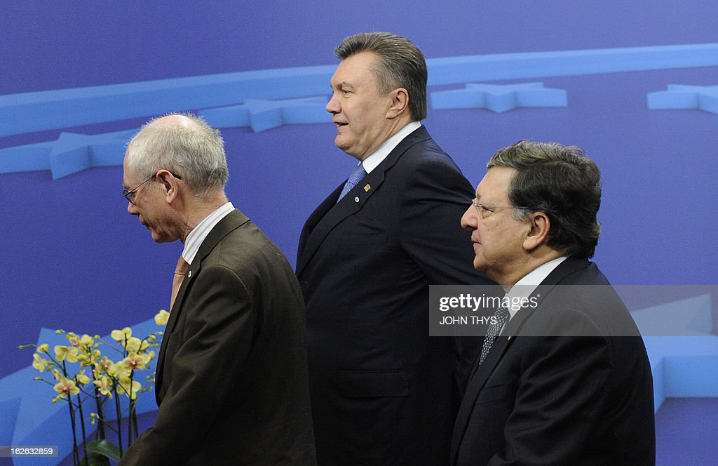 European Union President Belgian Herman Van Rompuy (L), European Commission President Jose Manuel (R)Barroso welcome Ukrainian Prime minister Viktor Yanukovych (C) before an EU-Ukraine Summit at the EU Headquarters in Brussels on February 25, 2013.