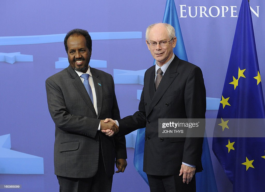European Union President Belgian Herman Van Rompuy (R) welcomes President of Somalia Hassan Sheikh Mohamud before to their bilateral meeting at EU Headquarters in Brussels on January 30, 2013. AFP PHOTO /JOHN THYS