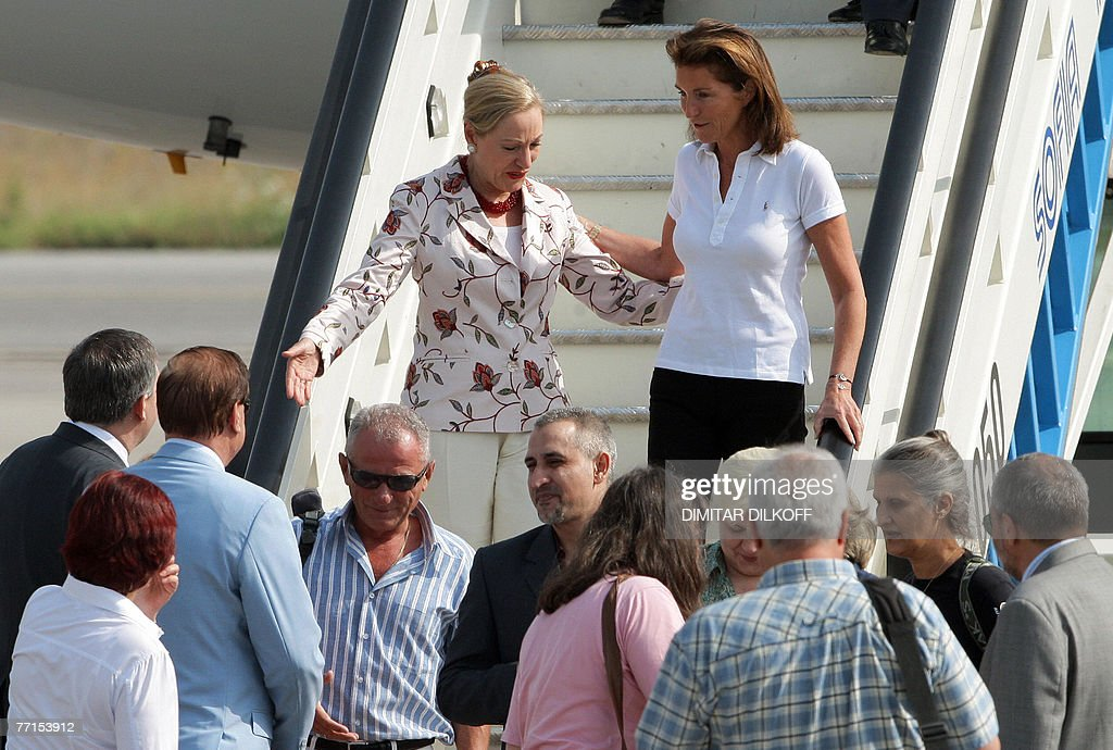 European Union's External Relations Commissioner Benita FerreroWaldner and France's first lady Cecilia Sarkozy discuss outside the French...
