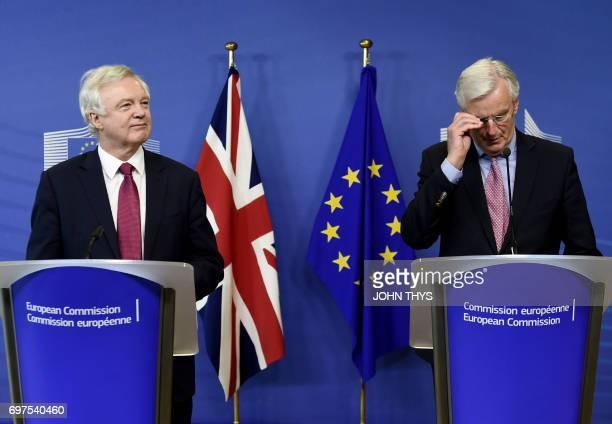 European Union's French chief Brexit negotiator Michel Barnier adjusts his glasses as British Secretary of State for Exiting the European Union David...