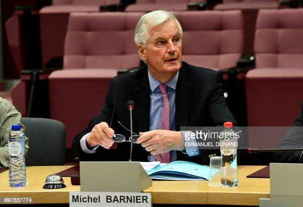 European Union's French chief Brexit negotiator Michel Barnier and his delegation attends a meeting with British Secretary of State for Exiting the...