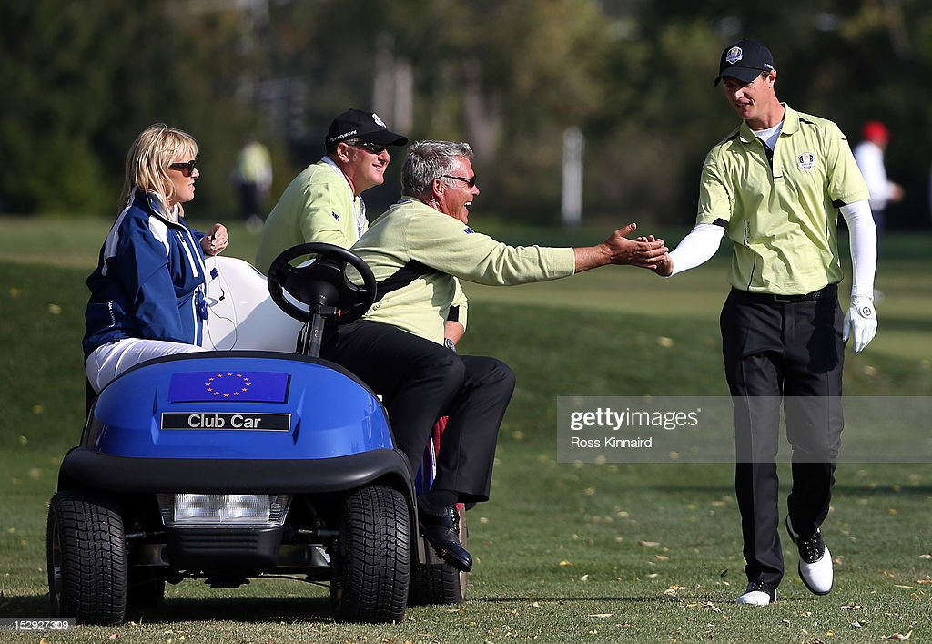 European vice captain Darren Clarke greets Nicolas Colsaerts on the tenth hole during the Afternoon FourBall Matches for The 39th Ryder Cup at...