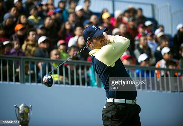 Europe's David Howell tees off as he parteners Marc Warren to half with Liang Wenchong and Wu Ashun of China on the secondday of the seventh edition...
