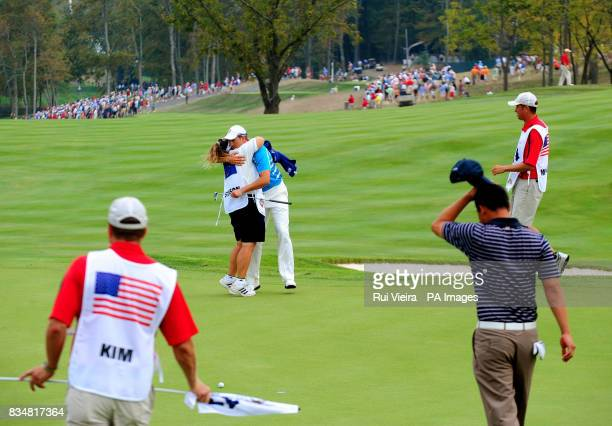 Europe's Henrik Stenson hugs his caddy after winning the Foursome match against USA's Phil Mickelson and Anthony Kim after The Foursomes on Day Two...