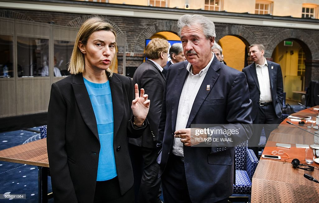 Europe's High Representative for Foreign Affairs and Security Policy, Federica Mogherini (L) talks with Luxembourg Foreign Affairs minister Jean Asselborn at the start of the Informal Foreign Affairs Council at the Scheepvaartmuseum (Maritime Museum) in Amsterdam, on February 6, 2015. The European Union on Wednesday finally reached agreement on how to finance a three-billion-euro ($3.3-billion) deal to aid Syrian refugees in Turkey, in exchange for Ankara's help in stemming the flow of migrants. / AFP / ANP / Remko de Waal / Netherlands OUT