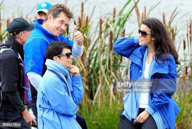 Europe's Lee Westwood gives the thumbs up as he stands with his wife Laurae Westwood and Luke Donald's wife Diane Donald after he won his match in...