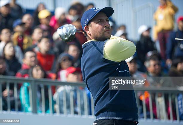 Europe's Marc Warren tees off as he parteners David Howell to half with Liang Wenchong and Wu Ashun of China on the secondday of the seventh edition...
