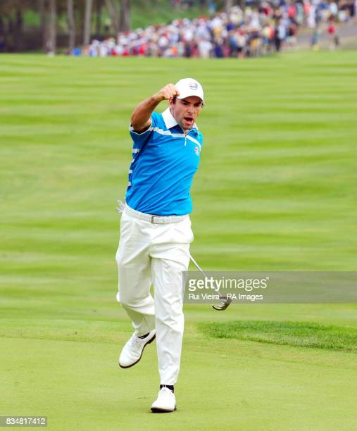 Europe's Oliver Wilson celebrates his put on the 17th to win the Foursome match against USA's Phil Mickelson and Anthony Kim during The Foursomes on...