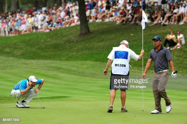 Europe's Oliver Wilson lines up a put on the 15th during the Foursome match against USA's Phil Mickelson and Anthony Kmi during The Foursomes on Day...