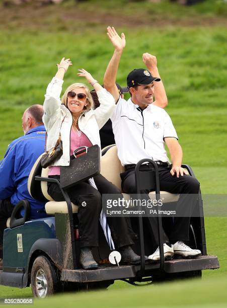 Europe's Padraig Harrington and his wife Caroline acknowledge the cheers of the crowd after he won his threesomes match with teammate Ross Fisher