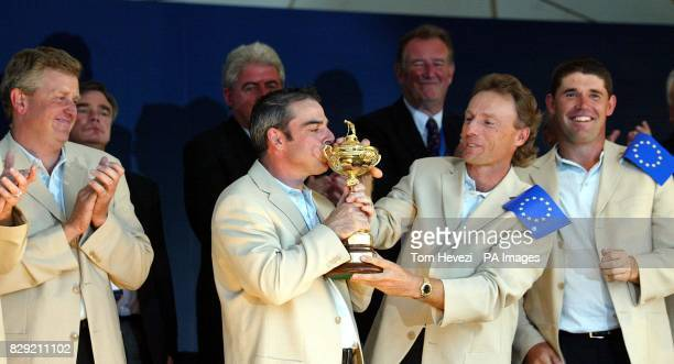 Europe's Paul McGinley kisses the Ryder Cup with teammates Colin Montgomerie Bernard Langer and Padraig Harrington watching on during the...