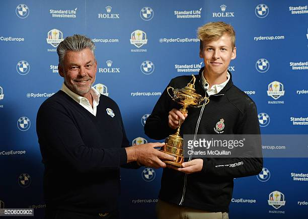 Europe's Ryder Cup captain Darren Clarke with son Tyrone Clarke at Royal Portrush golf club as part of the Ryder Cup Trophy Tour launch on April 12...