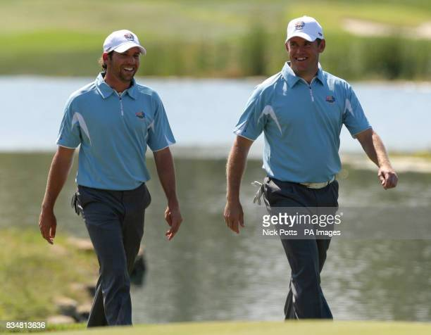 Europe's Sergio Garcia and Lee Westwood on the 7th green enjoy a laugh during practice at Valhalla Golf Club Louisville USA