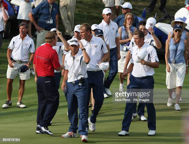 Europe's Sergio Garcia shows his dejection as the USA start their celebration on the 17th during Singles on Day Three at Valhalla Golf Club...