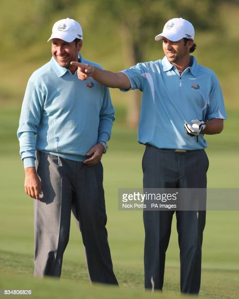 Europe's Sergio Garcia talks with assistant captain Jose Maria Olazabal during the team practise at Valhalla Golf Club Louisville USA