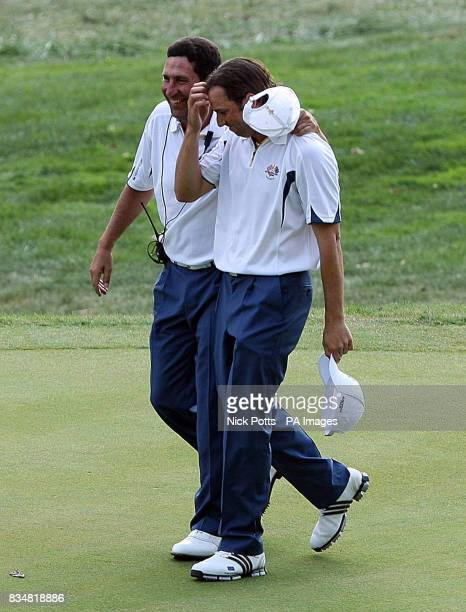 Europe's Sergio Garcia with Jose Maria Olazabal shows his dejection after his defeat to USA's Anthony Kim on the 15th green during Singles on Day...