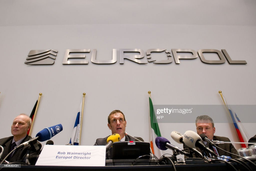 Europol's chief Rob Wainwright (C) speaks next to Friedhelm Althans, chief investigator of Bochum police (L) and Andreas Bachmann (R) from the Bochum prosecution service during a press conference in The Hague on February 4, 2013 after the police smashed a criminal network suspected of fixing 380 football matches, including in the Champions League and World Cup qualifiers. 'It is clear to us that this is the biggest investigation ever into suspected match fixing,' Wainwright told journalists. AFP PHOT / ANP / ROBIN VAN LONKHUIJSEN netherlands out - belgium out
