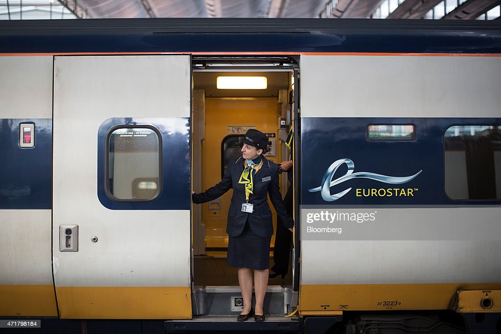A Eurostar employee stands in the doorway of passenger train operated by Eurostar International Ltd at St Pancras International railway station in...