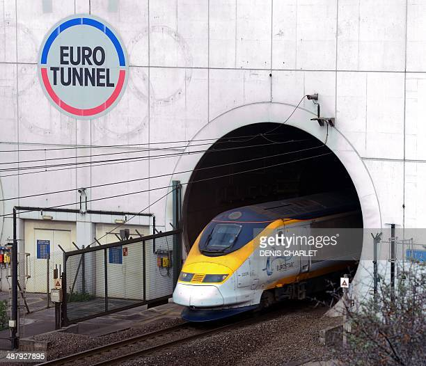 Eurostar train comes out of the Channel Tunnel owned by EuroTunnel on April 10 2014 in Coquelles northern France Twenty years ago Queen Elizabeth II...