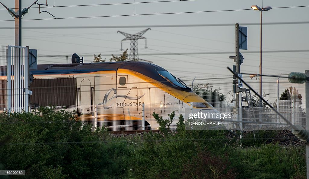 A Eurostar train is seen waiting to cross from the Channel to England at the CalaisFrethun train station in northern France on September 2 2015...