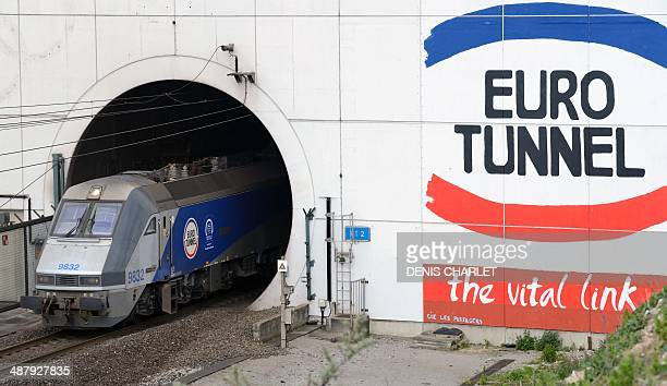 EuroTunnel train comes out of the Channel Tunnel owned by EuroTunnel on April 10 2014 in Coquelles northern France Twenty years ago Queen Elizabeth...