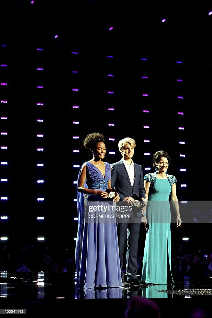 Eurovision Song Contest hosts Haddy Jatou N'jie (L), Erik Solbakken (C) and Nadia Hasnaoui speak at the semi-finals of the Eurovision Song Contest in Telenor Arena in Baerum, Norway, on May 25, 2010. The 55th Eurovision Song Contest finale will take place on May 29 in the Telenor Arena in Oslo, after Norwegian Alexander Rydbak took the top prize in Moscow last year with his song 'Fairytale'. AFP PHOTO/NORWAY/Cornelius Poppe ==NORWAY