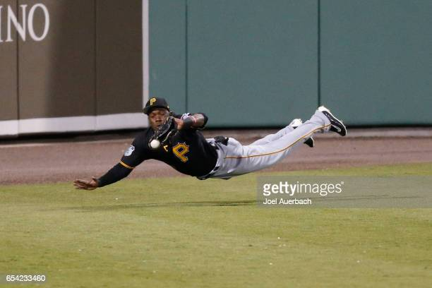 Eury Perez of the Pittsburgh Pirates is unable to catch the ball hit by Brock Holt of the Boston Red Sox which went for a triple in the sixth inning...