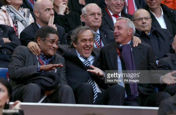 Eusebio UEFA President Michel Platini and Johan Cruyff in the stands at the Amsterdam Arena before the game