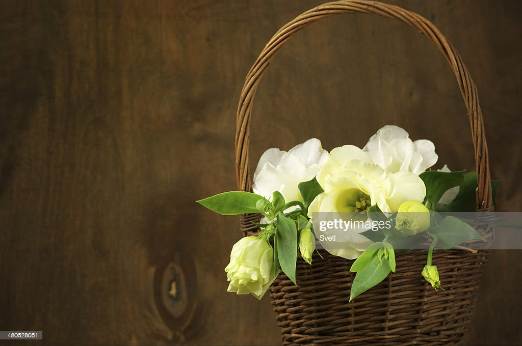 Eustoma flowers in basket : Bildbanksbilder