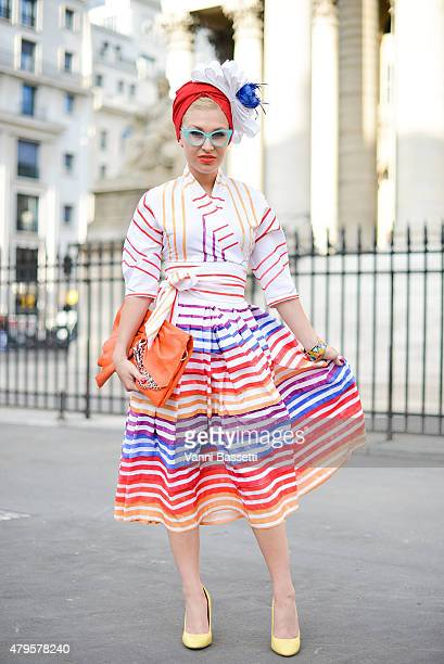 Eva Ana Kazic poses wearing an All Around Eve total look before the Atelier Versace show at the Palais Brogniart on July 5 2015 in Paris France