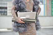 Eva Ana Kazic poses wearing an Eber fur Mbu dress and All Around Eve clutch on Day 7 of Paris Fashion Week Womenswear FW15 on March 9 2015 in Paris...