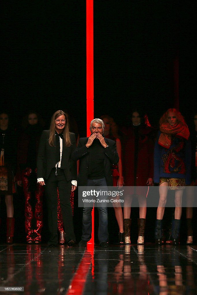 Eva and Roberto Cavalli acknowledge the applause of the audience after the Just Cavalli fashion show during Milan Fashion Week Womenswear Fall/Winter 2013/14 on February 21, 2013 in Milan, Italy.