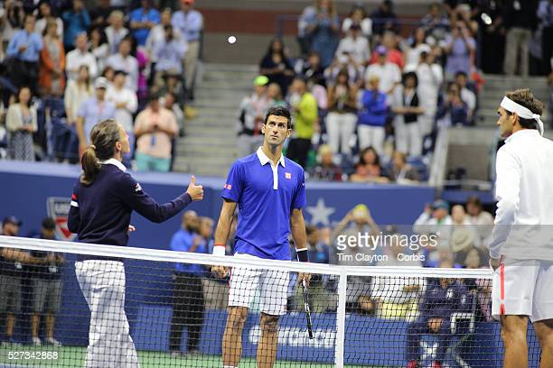 Eva AsderakiMoore of Greece the first female chair umpire for a US Open men's singles final tosses the coin before the start of the Roger Federer...